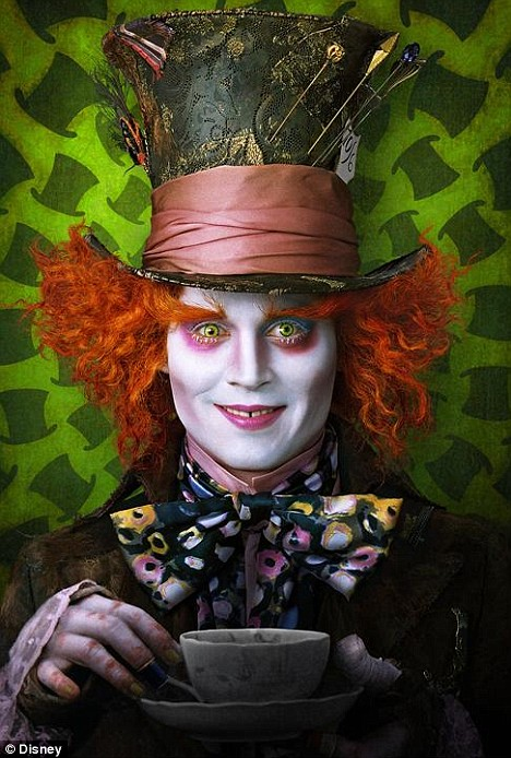 A shockingly red-haired, crazed, badly-dressed Johnny Depp as the Mad Hatter.