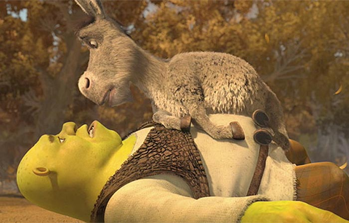 Donkey perches atop Shrek in classic style.