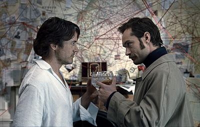 Holmes and Watson stand before Holmes' conspiracy map
