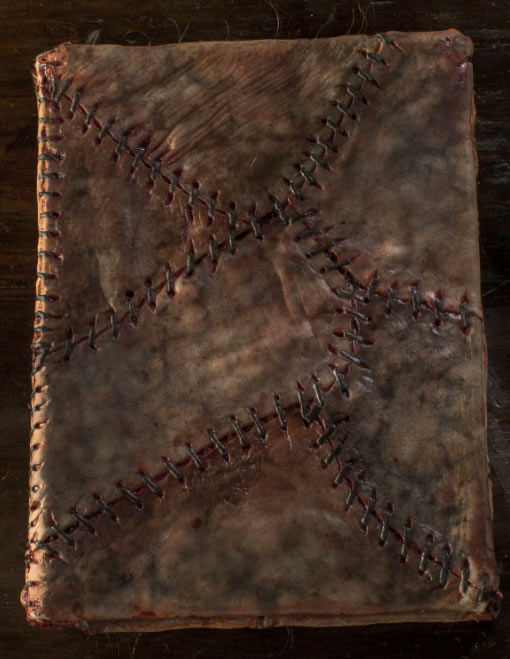 The scary old book bound in human skin. I wouldn't even want to touch it.
