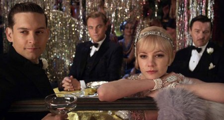 Nick, Gatsby, Daisy, and Tom watch the other guests at one of Gatsby's parties.