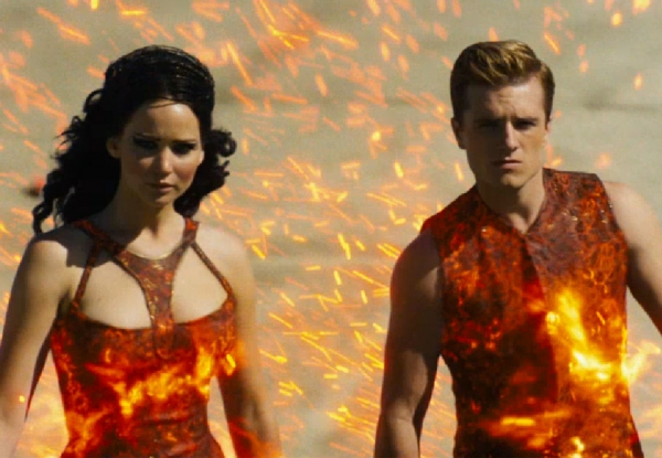 Katniss and Peeta on fire for their grand entrance. Well, some like it hot.
