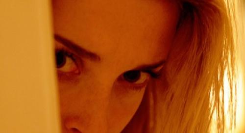 Em peeks around the corner, seeking to find herself.