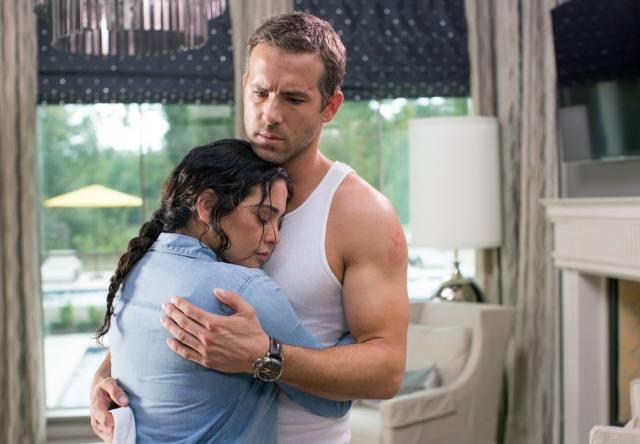 """Damian and his """"wife"""" share a really awkward hug."""