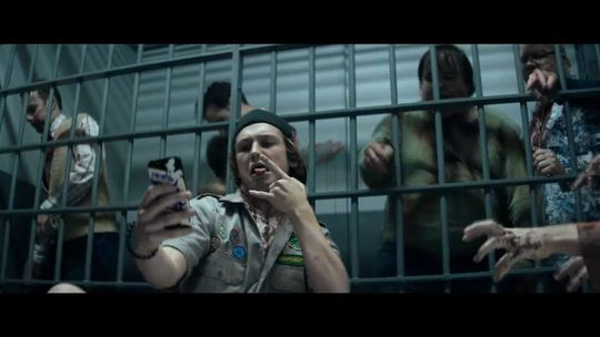 Carter pauses for a selfie during the zombie apocalypse.