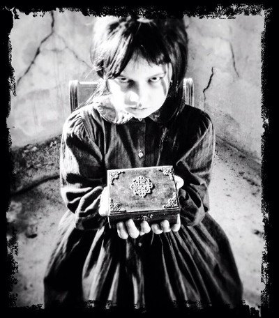 Little Girl with Box. She's creepy but not very bright.