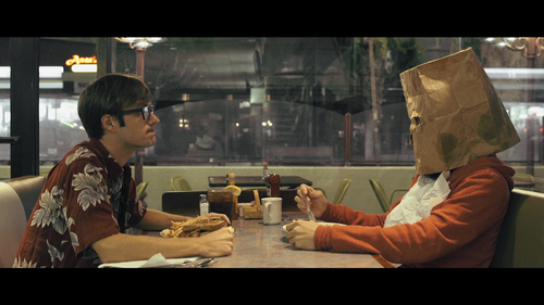 Anthony and Spaghettiman at a diner. Yes, he eats soup with a bag over his head.