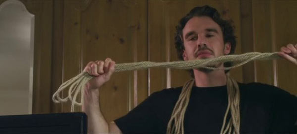 The stranger with his favorite tool. He's really into the whole rope thing.