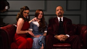 Ice-T entertains some guests. No, the one in the middle isn't happy to be there.