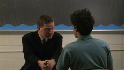 The headmaster lectures Issac. Sorry kid, but you just don't have any character.