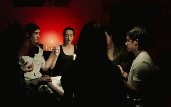 The seance, just before it goes horribly wrong.