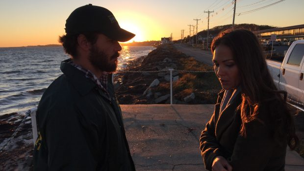Mike and Elizabeth in a tense moment with a gorgeous sunset behind them.
