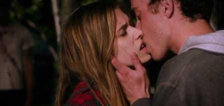Kim and Franky kiss. Never do this in a horror movie, kids.